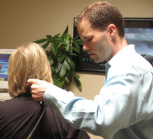 Dr. Brent using the Pro-Adjuster on a Patient's Neck